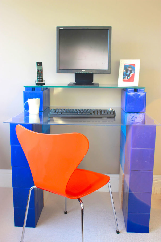 Here's a truly novel idea: using bright blue EverBlocks to craft a full size, two-tier computer desk. With the simple addition of a couple glass panels, the blocks are instantly transformed into a useful work space.