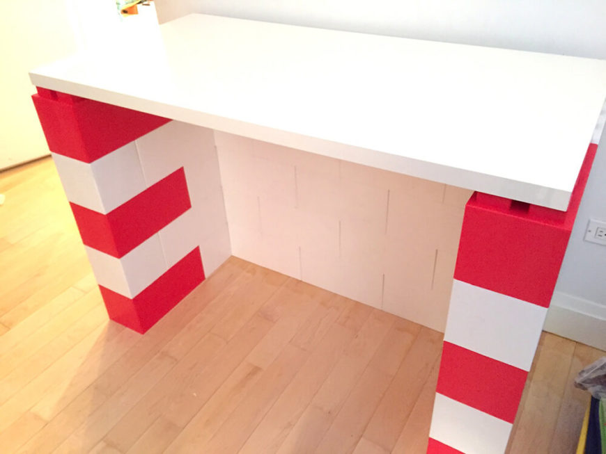 This looks like a festive pretend fireplace, perfect for kids to build around the holidays. A simple white top was added to complete the picture.