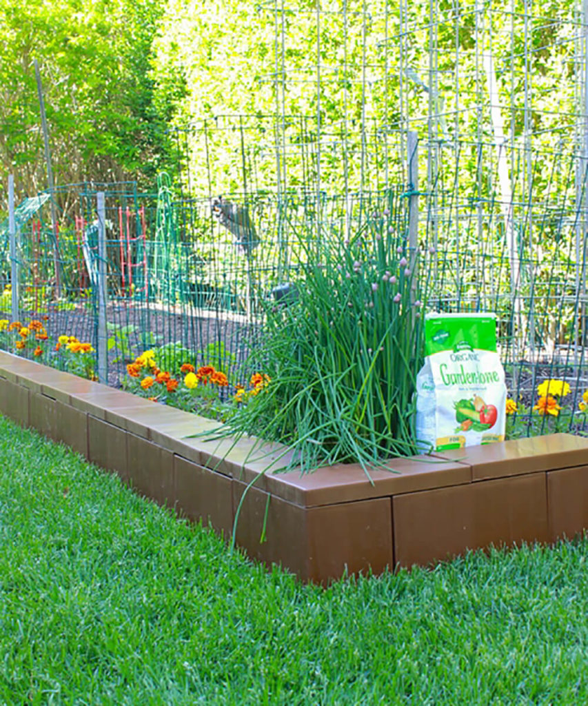 EverBlocks can be used for more adult business in the yard. Pictured here is a bespoke garden wall that helps contain and define the garden amidst a lush lawn.