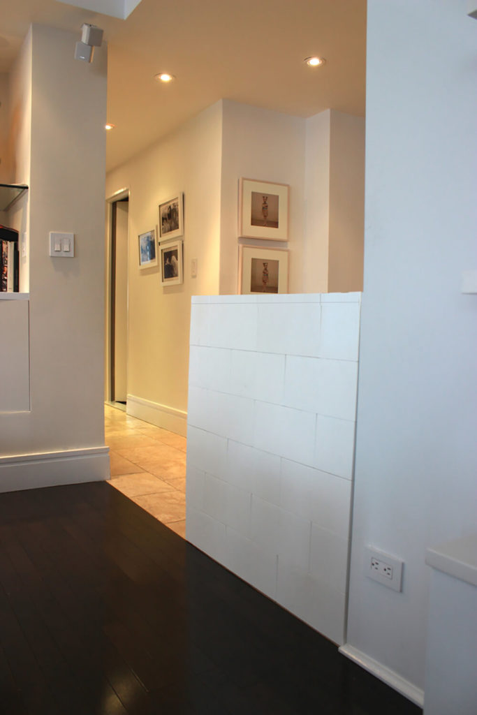 Here's an example of the blocks being deployed to utterly subtle effect, as a low wall extension within a white home. The addition is nearly seamless.