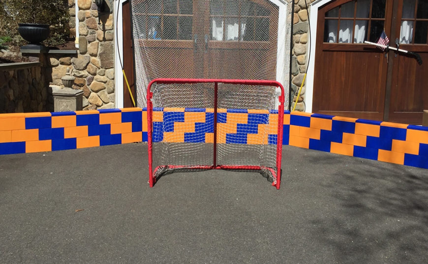 Moving outdoors, we see how older kids can make fantastic use of the blocks as a way to define their sports and games. This set of orange and blue blocks has become an impromptu hockey rink.
