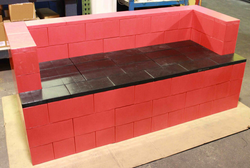 Here's a gorgeous red and black bench built from EverBlocks, making for a sturdy structure that would work perfectly in a mudroom or patio setting.
