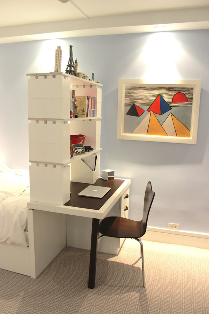 Sometimes, it's best to combine the blocks with existing pieces of furniture. In this room, we see a towering bookshelf planted on a unique desk and bed combination.