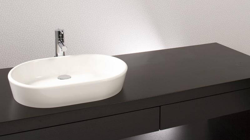 Slightly longer than the previous model, this vessel sink from the Ove collection has graduated from a more circular form into an oval, while keeping the trademark silky curves of the collection. This sink requires wall or countertop plumbing installation and is available in True High Gloss™ or matte finishes.