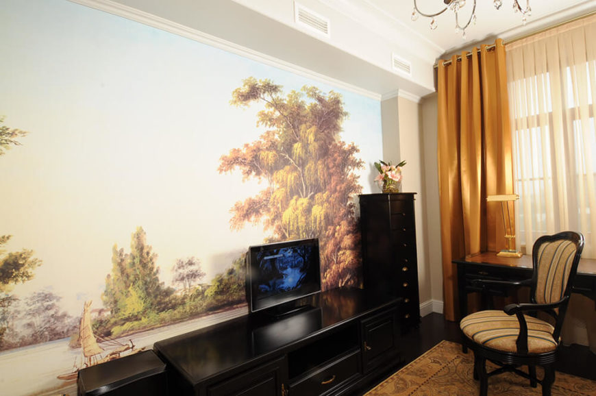 Behind the media shelving, we see another truly unique design flourish: a full wall-size nature painting that helps to bright and define this room within the home. It's another singularly personal touch.
