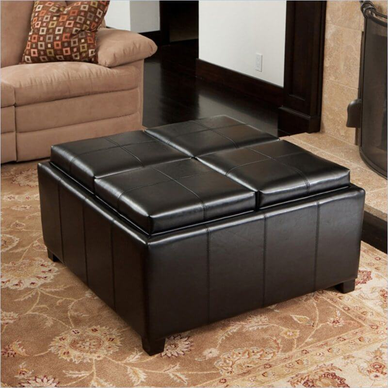 This large square ottoman features a unique surface feature wherein each of the four cushions can be removed to access inner storage, or flipped to reveal a framed, flat wood surface. This transforms it into a modular coffee table with four discrete table tops.
