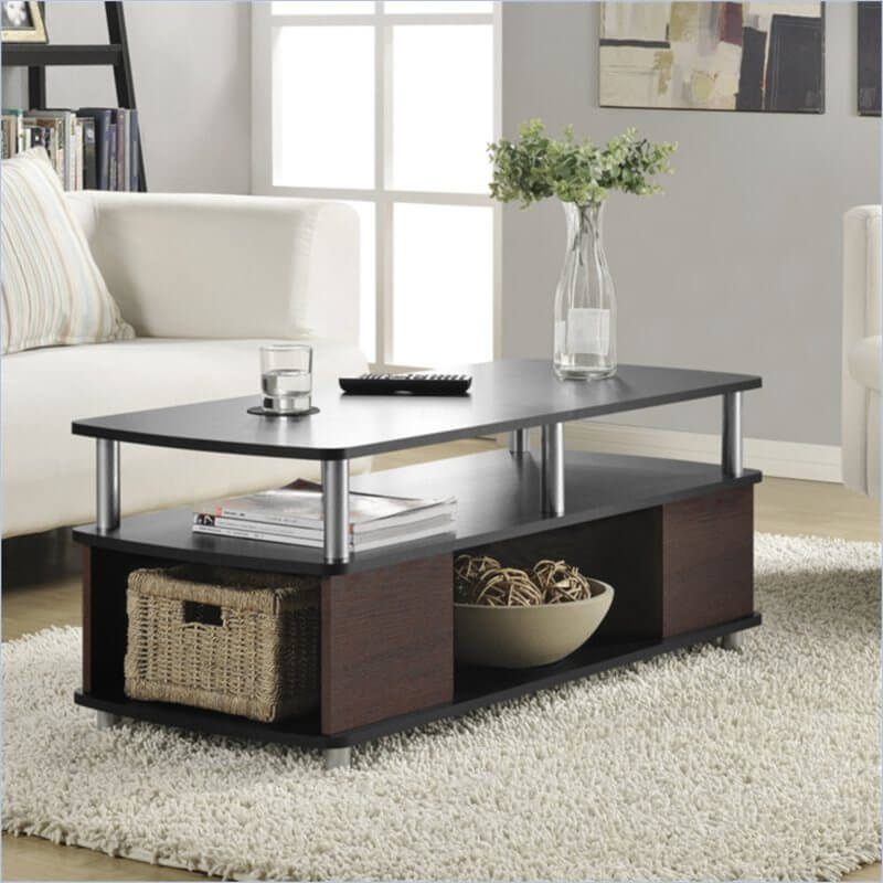 This large contemporary styled coffee table features two full tiers of surface area separated by steel beams, all over a dark wood frame with plentiful storage cubbies on all sides. It's got the perfect place to store extra items, a safe place to set drinks when the cat is around, and a clean and simple design.