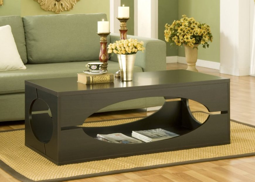 This has got to be one of the most unique coffee tables we've seen. The box-like frame is cut out with large circles on each side to allow access to the entirely open interior. The amount of storage is breathtaking and beautifully displayed.