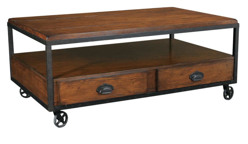 This industrial table returns to the idea of wrought iron wheels for support, with a two-tiered surface and abundant storage in rich wood, tucked into the dark metal frame.