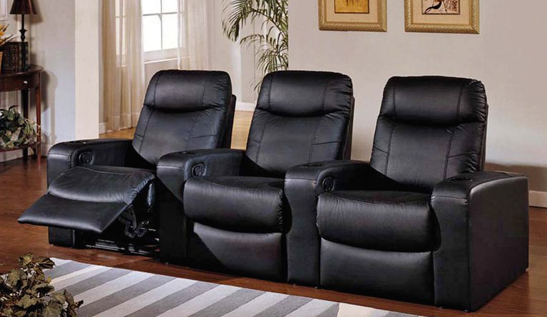 This thick cushioned recliner set is positioned similarly to our first model, with ample space for drinks between the seats themselves. The reclining motions ensures ultimate comfort in a relatively compact frame.