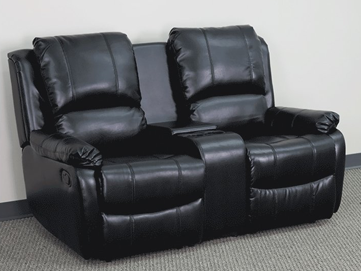If you're looking for the perfect seating arrangement for couples, this unique setup might be the best option. A pair of reclining seats are framed in solid black leather, with an extra-wide armrest at center that provides a lift-stop storage bin in addition to a pair of useful cupholders.