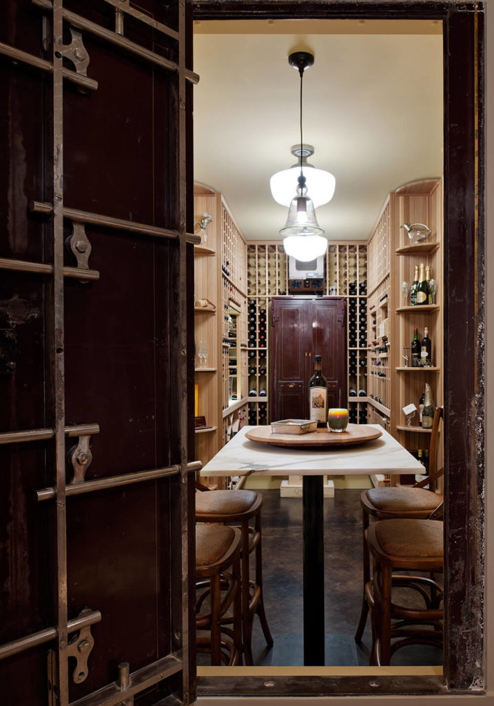 The home has repurposed an old vault into a bespoke wine cellar with in-room dining table made of white marble. Personalized details like this truly set the home apart.