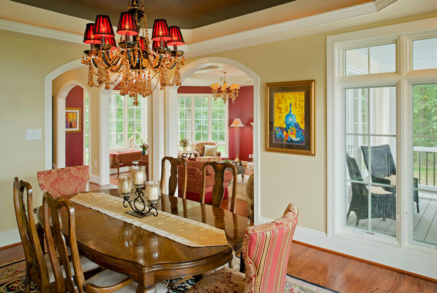 The dining room opens to the living room and hallway. It carries the red and gold color scheme of the house well while incorporating antiques and fabric seen in the other rooms. This chandelier is quite stunning with its amber beads, crystals, and small red shades.