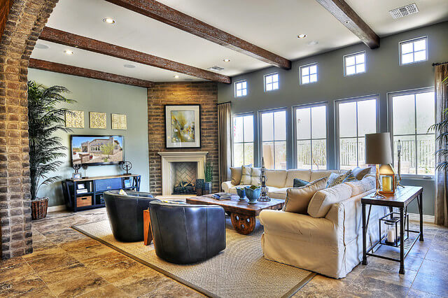 Coronado Stone Products AdobeVeneer Again, just a sliver of brick, when added with elements like the the exposed ceiling beams and the polished brick flooring, goes a long way. This room does an excellent job of mixing both modern and antique elements in a fresh and engaging style.