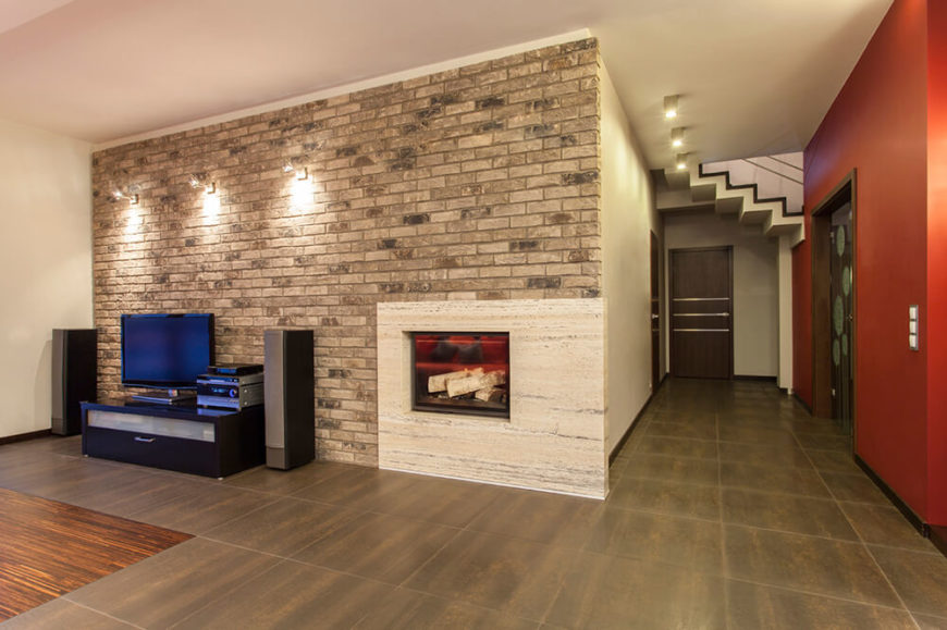 Brick and fireplaces go together well, primary due to brick's high heat tolerance. In this room, a rectangle of marble encloses the fireplace, while standard bricks surround the marble slab.