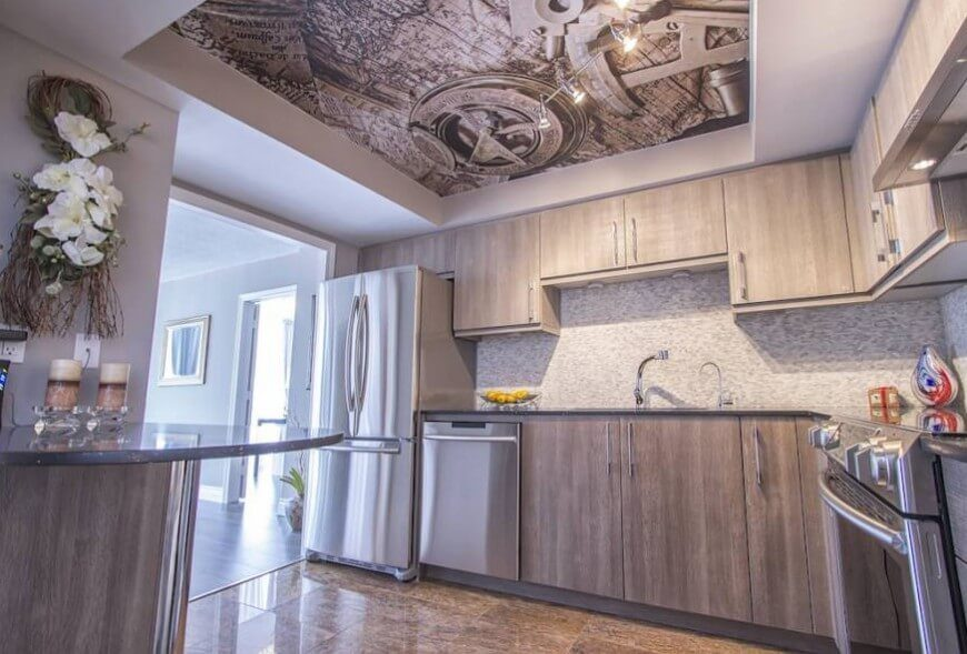 ... Stainless Steel Appliances. Beneath A Bold Art Print On The Ceiling Of  This Kitchen, We See Light Grey