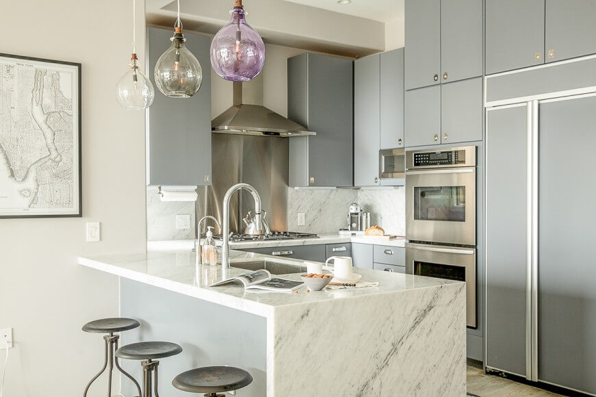 This Cozy But Open Kitchen Is Defined By The Pairing Of Sleek Grey Cabinetry  And White