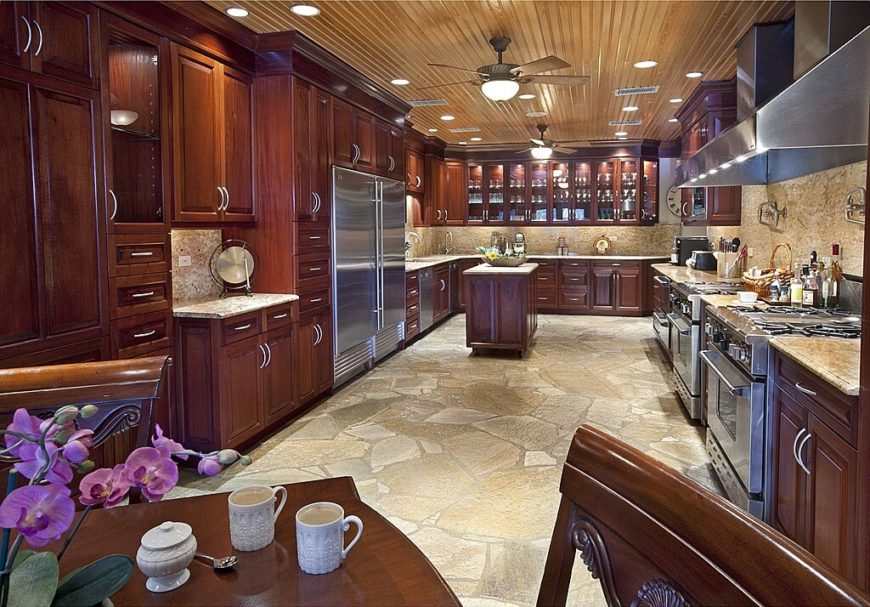 This Vast Kitchen Features Acres Of Rich Wood Cabinetry, Plus Marble  Countertops And Backsplash Over
