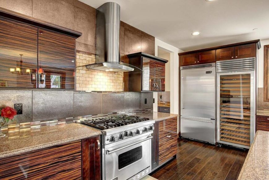Ordinary Kitchen Ideas With Stainless Steel Appliances Part - 2: We Love The Sleek Texture Of The Wood Cabinetry In This Kitchen, Adding A  Glossy