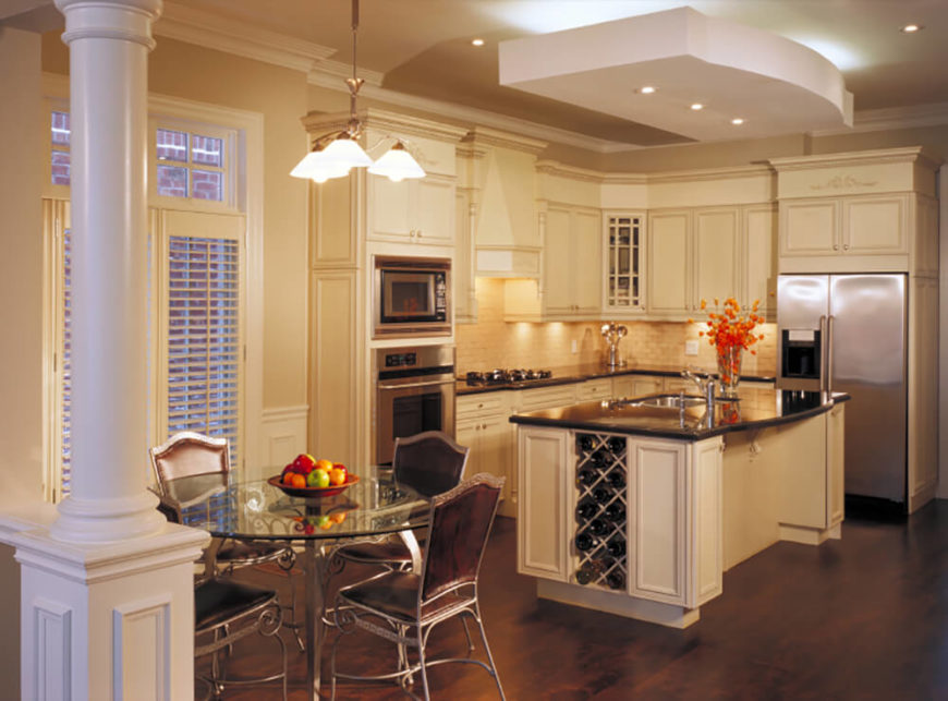 A Large Island Centers This Kitchen Over Dark Hardwood Flooring, With A  Sleek Black Countertop