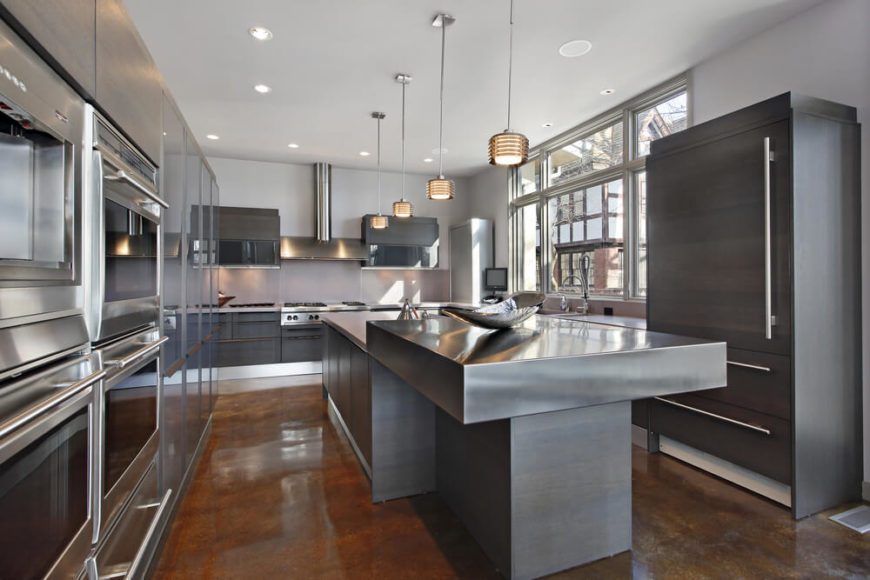 This Kitchen Features A Strong Balance Between Various Modern Elements,  From The Glossy Brown Flooring
