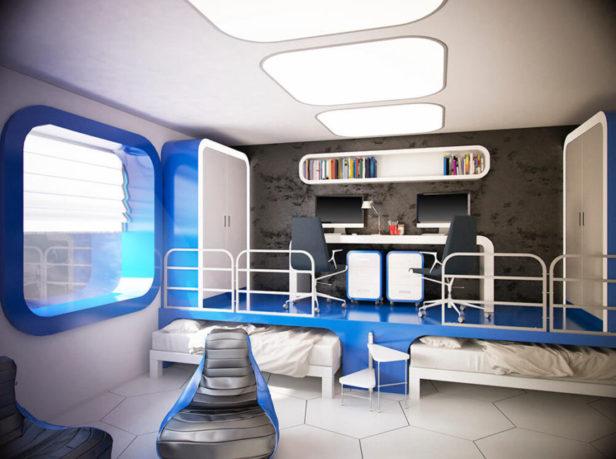 This bedroom is very futuristic. Aside from the large floor tiles, you would be hard stretched to find a sharp angle in the room, as mostly all of the edges have a soft curve. The design of the space is very unique, in that the two beds pull out from beneath the raised level, on top of which a working desk is featured, with two computers and chairs.