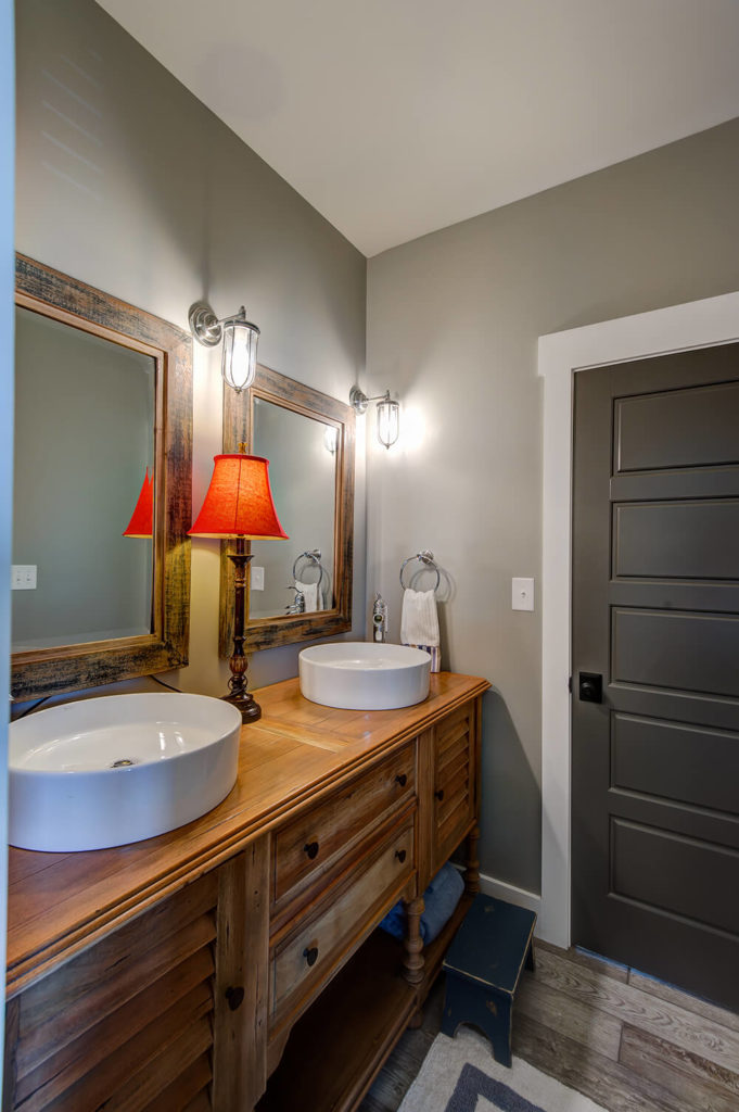 One of the downstairs bathrooms features clean lines and the same wash basin style as the upstairs bathrooms. Storage under the sinks frees up space typically reserved for additional, space-gobbling wall shelving and closets.