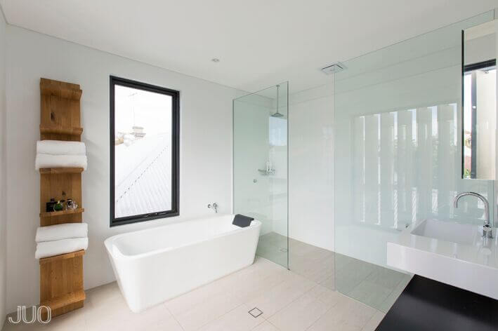 Bathroom with Picture Window Next to Tub