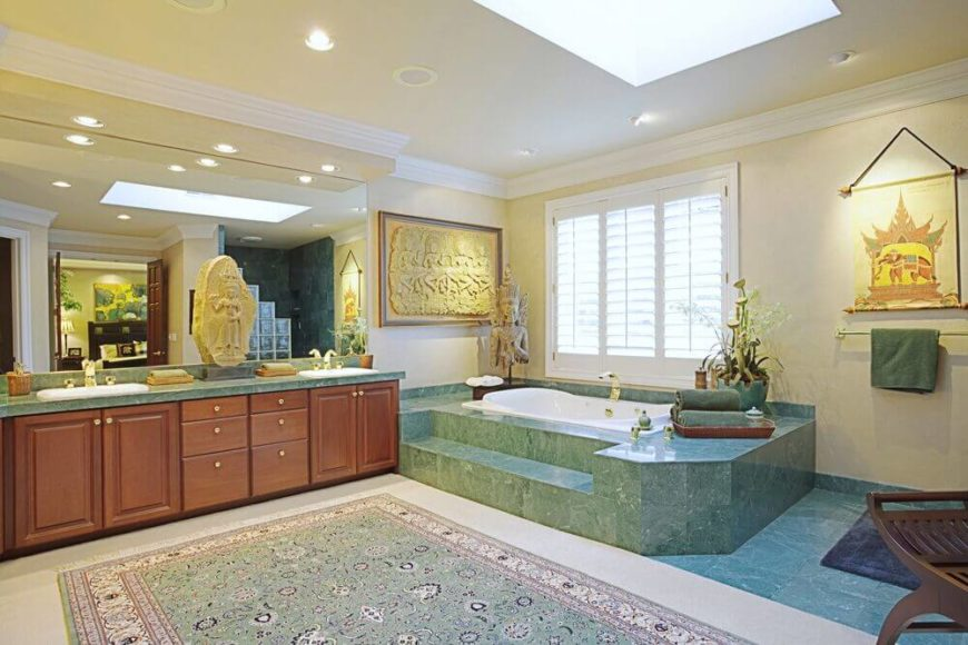 Large Bathroom With Windows Next To Tub And Skylights
