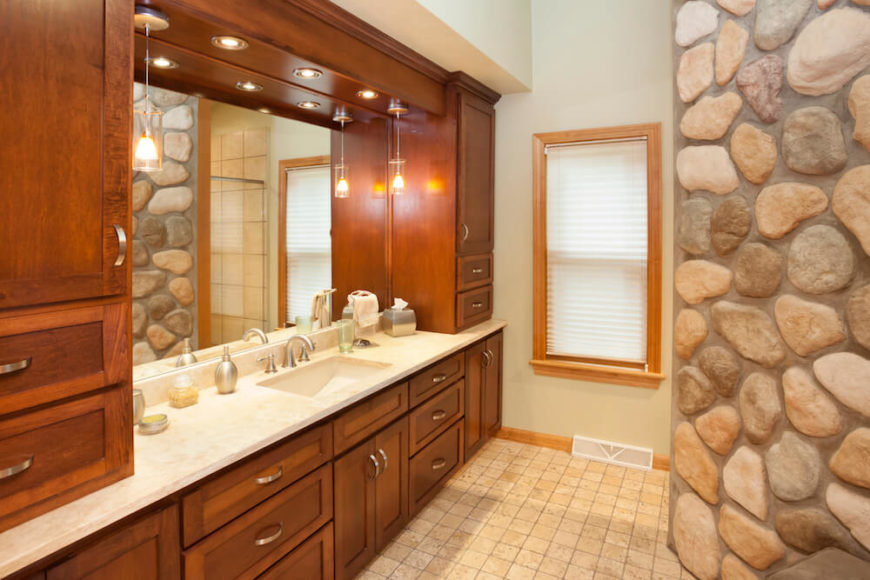 Bathroom With Wood Framed Window And Blinds