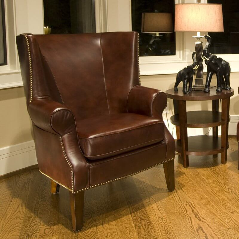 This handsome, top grain leather chair provides an image of sophistication and tradition. With classically styled roll arms, antiqued brass nail head accents, and simple, solid wood feet, this is a beautiful chair that doesn't come off as too extravagant or oversized.