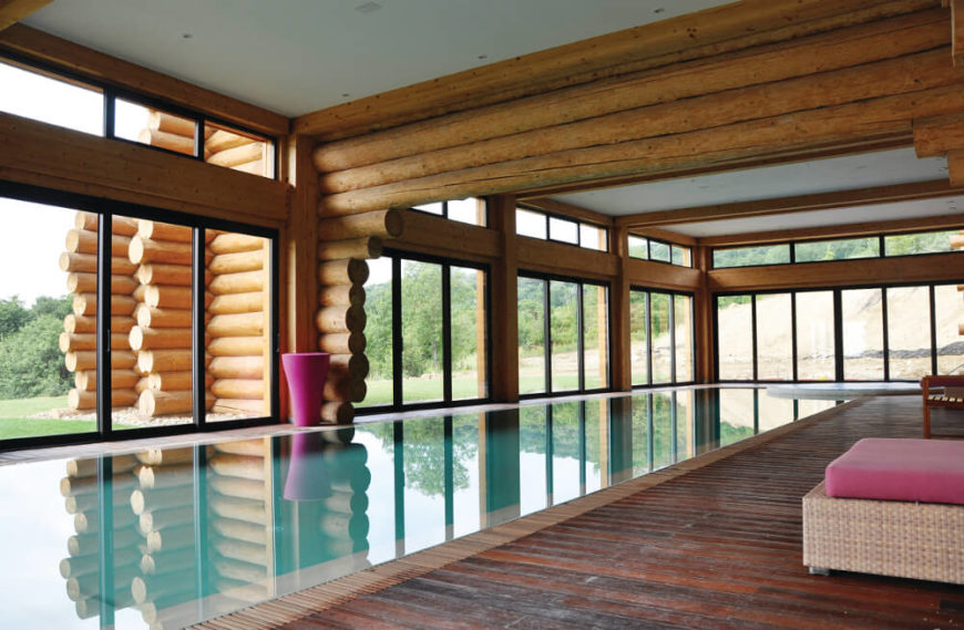 The pool room is an expansive, open interior space completely wrapped in full height windows for an open, airy look. The dehumidification elements work here to keep the home free of any possible moisture damage.