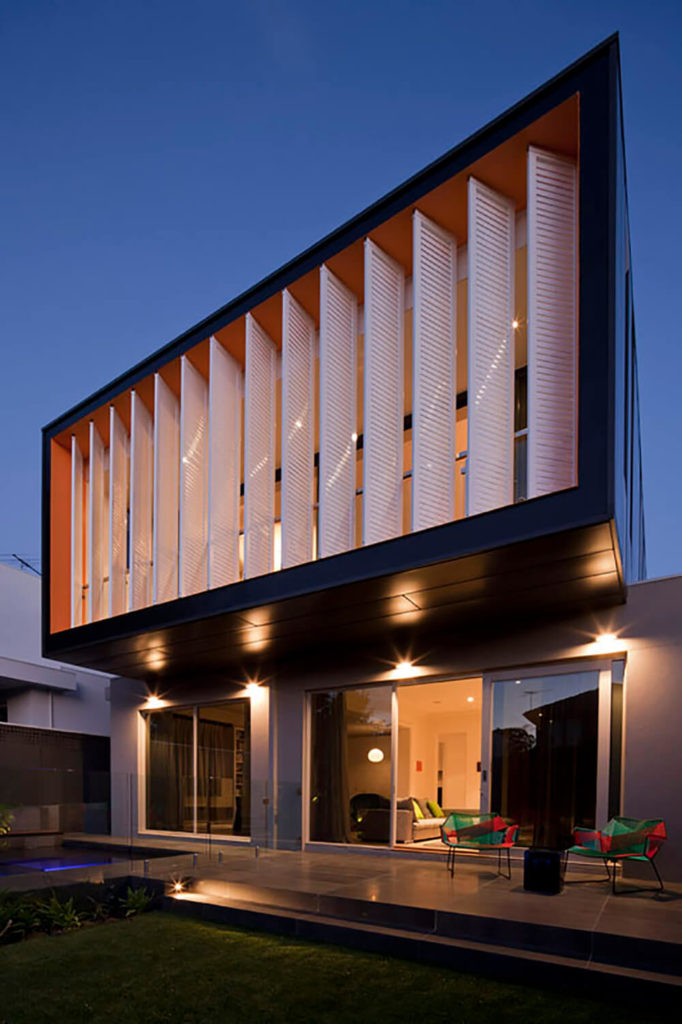 In order to add the space needed to the second floor without overshadowing the surrounding neighbors the designers decided to create a sharp, modern 'box' that cantilevered over the existing house. This created a bold architectural statement when the addition is viewed from the backyard.