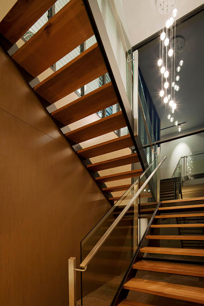 Here you can see the gorgeous cascading bubbles of light that light up the stairwell in the evening. The glass and sleek metal banisters help to ensure that the most light can get into the home.