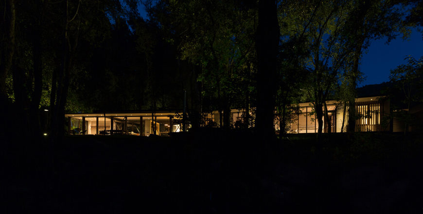 Whether night or day, this home's design proves that it is possible to work with a site's existing topography and natural elements instead of using the bulldozer to customize the location of the house.
