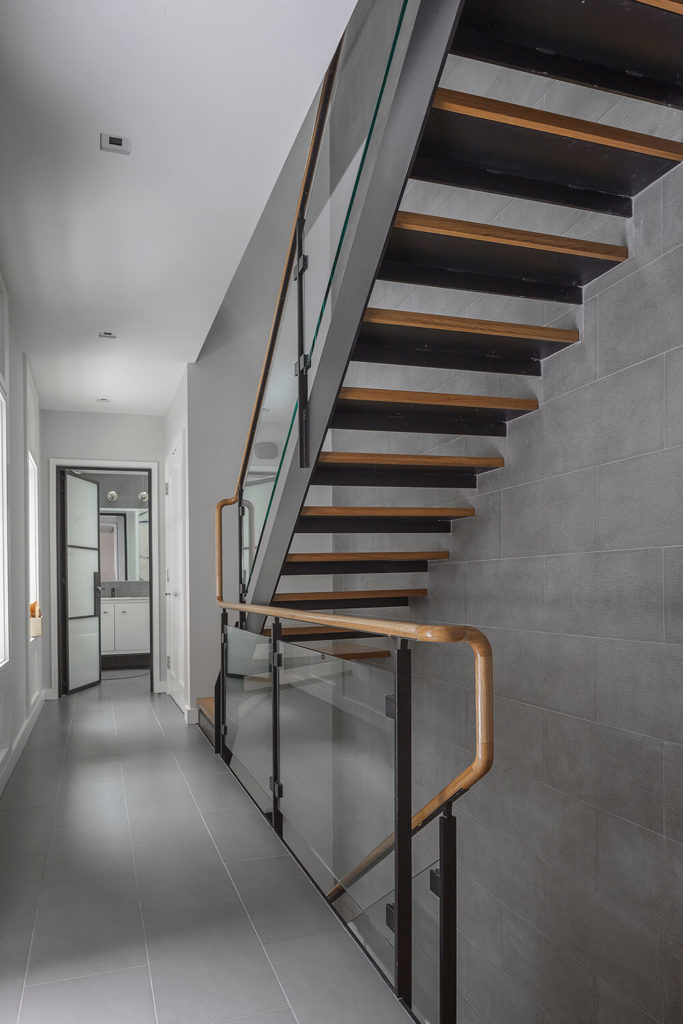 This staircase is separate from the one pictured above. This set provides a more practical and efficient way to get to the different service areas of the home, such as the washing rooms, laundry rooms, and kitchen areas.