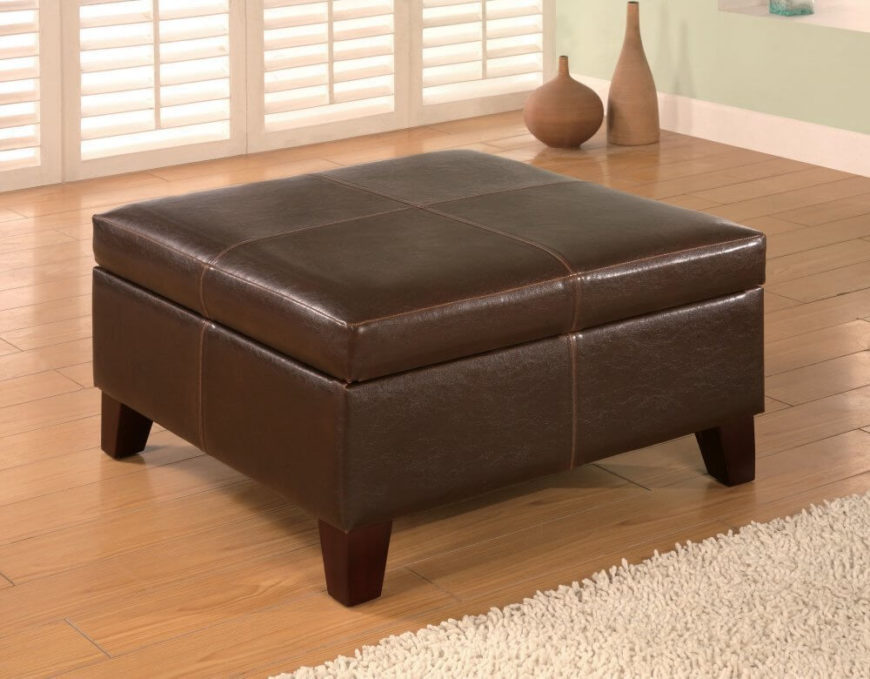 This stylish contemporary ottoman is wrapped in a dark chocolate leather-look vinyl with sturdy wooden legs. The top of the ottoman lifts off to reveal a spacious hidden storage compartment to help you keep your space tidy.