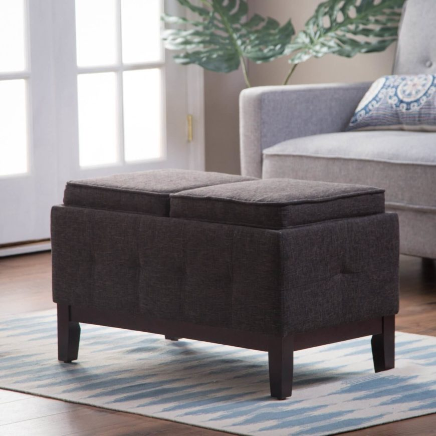 This storage ottoman is upholstered in a versatile dark gray fabric that works well with a variety of different styles and furniture. The underside of each cushion has a flat surface, so that when flipped, the ottoman becomes the perfect spot to set up drinks and snacks during the game or a movie.