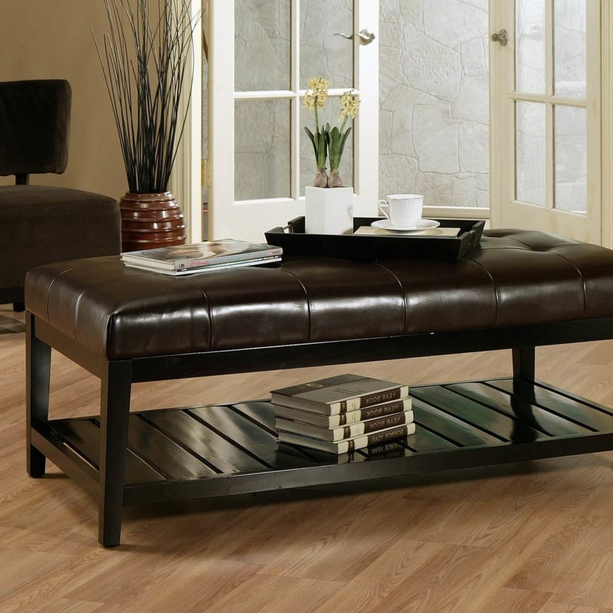 An attractive and useful ottoman that is incredible versatile, with a sleek, bicast leather top that's flat and wide enough to serve as a lovely coffee table with the addition of a simple tray table.