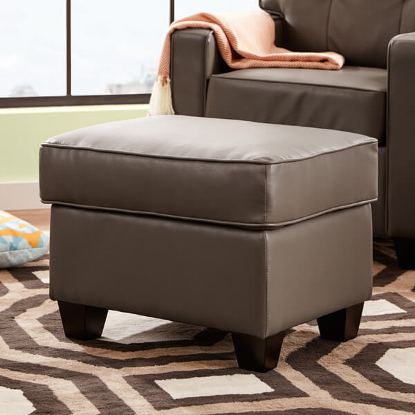 The sleek modern silhouette of this small ottoman is an easy addition to make to any design scheme. The clean lines and sharp faux leather upholstery make this an incredible option for any man cave.