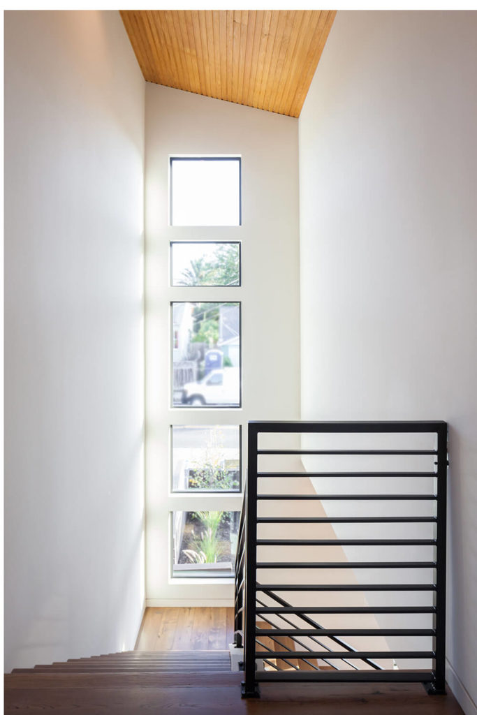 This view from the top of the staircase shows the benefit of numerous/large windows in a home. Sunlight from these windows shines up to the top of the staircase, and also floods down into the lower level.