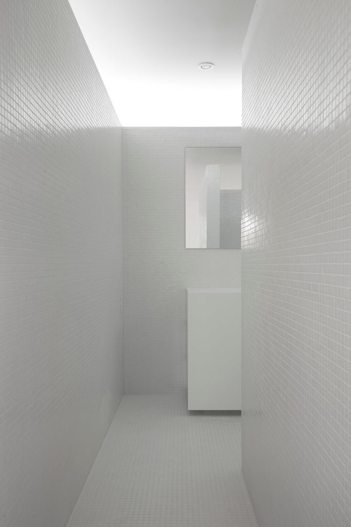 This view from the bathroom entrance displays that even when standing directly before the entrance of the bathroom, the configuration of walls provides sufficient privacy.