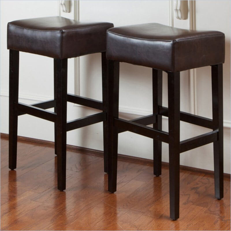 This side-saddle shape is one of the most popular styles of bar stool today. Found in many homes ranging from traditional to ultra-modern the style has a timeless appeal and unshowy elegance that makes it fit well nearly anywhere. For your man cave, you might enjoy the added comfort of its thick seat padding and the richness of the dark wood frame.