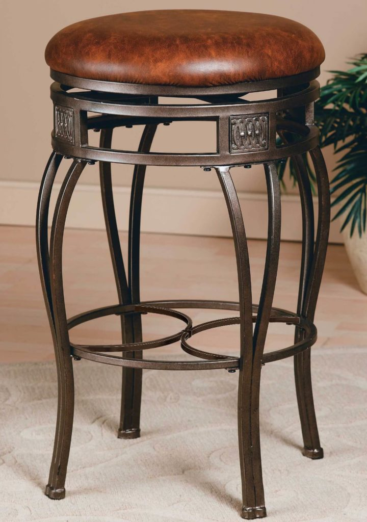We adore the old steel look of this rather ornate, backless bar stool. The rich, warm toned leather upholstery rides atop an ornate frame for a combination of strong textures and tones. This stool would fit perfectly in any elegant, luxury-oriented man cave. If your room is a place where rich wood and fireplaces appear, a stool like this could be the key to completing the look.