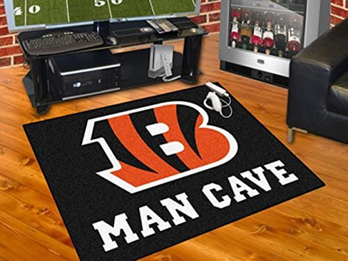 Very similar to our above hockey puck rug, this one is for the football fans out there. The rug is large, grips to the floor, and the black background means that it'll work with most rooms. Of course, the key appeal is that it can be decorated with the NFL team of your choice! Perfect for sports themed man caves.