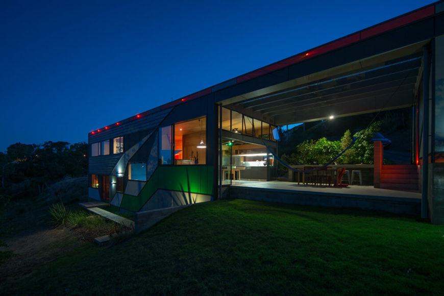 Here we see how, at night, strategically embedded lighting along the structure of the home highlights the various colorful patches and angular shapes.