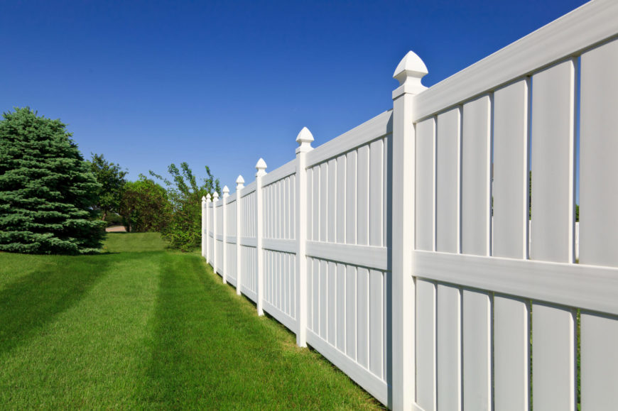 A vinyl privacy fence with space between each slat. This is an example of an incredibly simple design that looks fantastic and performs its functions perfectly.
