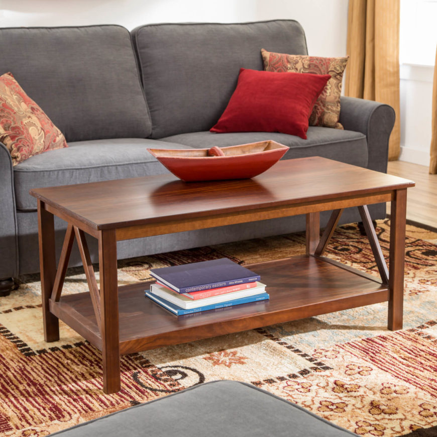 This stylish coffee table is about as far as you could get from the prior model while still remaining a piece of Craftsman home furnishing. Constructed of richly stained wood panels in slimmer pieces, it's a more open, modern looking table with a rather minimalist presence. A triangular design on the sides is all the embellishment it needs.