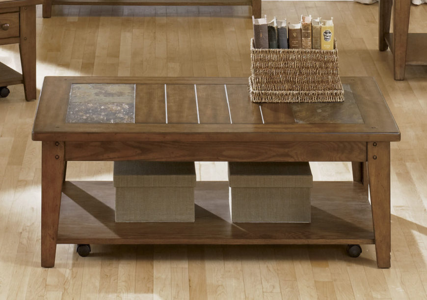 This rich natural wood coffee table is an exemplary form of Craftsman style, with thick clearly defined slats and solid legs forming a simple but elegant shape. The tabletop features a pair of natural slate accents for a bit of relatively extravagant style, plus a lower shelf for additional storage or display space.