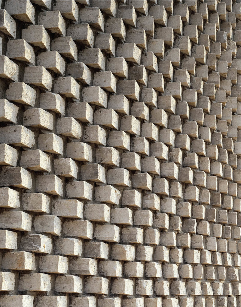 "Here's another look at the intricate ""pixelated"" brickwork covering the facade of the home. The cumulative effect here is mesmerizing."